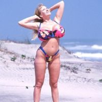 Blond solo model Kayla Kleevage looses her fake tits from a swimsuit while at the beach