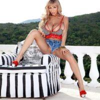 light-haired solo model Venera sets her huge titties free on a balcony in cut off denim cut-offs