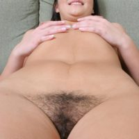 dark haired amateur touts her enticing caboose before showing the pink of her smooth-shaven cootchie