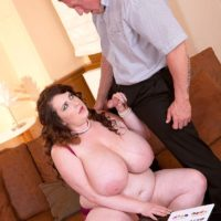 Black-haired BBW Anna Beck unsheathing massive boobs before giving ORAL SEX and screwing on couch