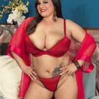 Dark-haired BBW Melonie Max titty strangling stud with humungous boobies in crimson lingerie