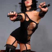 Brunette chick Belle Noir models for an upskirt gig in a revealing dress