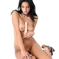 Brunette hottie Foxxi Black dildos her landing strip snatch after getting buck naked