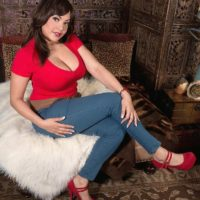 Brown-haired MILF Cat Bangles letting adorable knockers loose attired blue jeans and high heeled shoes