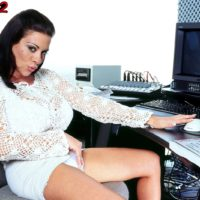 Brown-haired MILF Linsey Dawn McKenzie unveils her massive titties at her office place desk