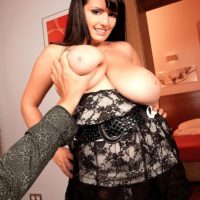 Black-haired MILF X-rated actress Arianna Sinn revealing monster-sized titties before delivering oral sex