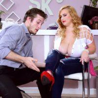 Bosomy light-haired BIG SEXY WOMAN Mya Blair wanking and fellating cock in torn blue denim jeans
