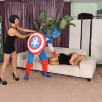 Huge-boobed golden-haired Karen Fisher engages in lesbo sex before a three-way with a fully-clothed dude