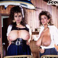 Bosomy X-rated film star Devon Daniels and her lezzie gf flaunt their humungous boobies