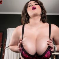 Plump stocking and lingerie garbed brunette Alana Lace having massive titties unsheathed
