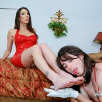 Clothed brunette Dom Dava Foxx training a crossdressing sissy maid with a flog in her hand