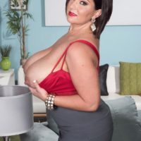 Curvy brown-haired MILF Paige Turner baring immense natural boobies from boulder-holders