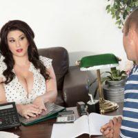 Dark-haired BBW XXX star Angel DeLuca having her massive boobs revealed in work place