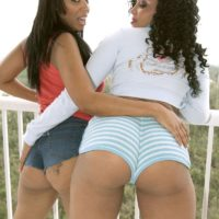 Black girls Soleil Hughes and Kandee Lixxx flaunt their monster-sized arses together