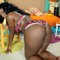 Black solo chick Mia Milan bare her boobs while flaunting her enormous ass in her bedroom