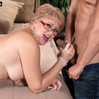 Elderly blonde dame Tracy Licks has her huge boobs liberated before providing a hand-job and blow-job