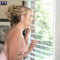 Enticing sandy-haired grandmother Mia Magnusson pulls out her breasts and smoothly-shaven vagina from lingerie