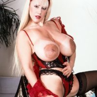 Prominent XXX film starlet Honey Moons has boobies so giant she can suck her own nips with ease