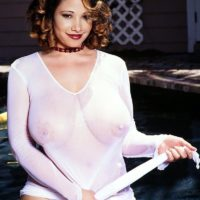 Notorious XXX pornstar Thru Paxton shows her uber-cute melons out by the swimming pool