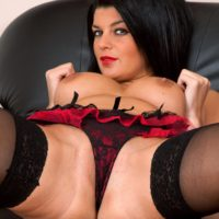 Fancy senior dame revealing gigantic all-natural breasts and adorable butt in hosiery and high heels