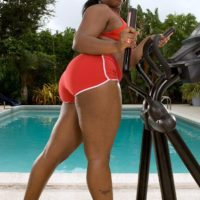 Over weight ebony chick Keyona Kay lubing up beguiling immense ass outdoors by swimming pool