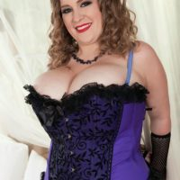 Plus size solo model Smiley Emma unveils her massive boobies in mesh hosiery and forearm socks