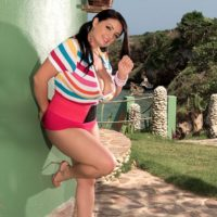 chunky black-haired MILF adult starlet Arianna Sinn licks a cone and her nipples while outdoors