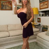 High heel garbed wife Holly Halston has her collared sissy provide her with cunnilingus