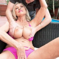 Hot 60 plus doll Katia has her hefty boobies groped by junior man on patio