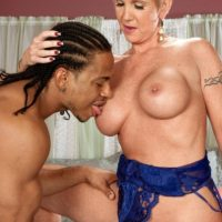 Foxy light-haired granny Honey Ray has her young black paramour suck her honeypot and chocolate-colored sphincter too