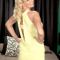Alluring platinum-blonde grandma Nikki Chevious tempts a junior black guy in a short dress