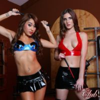 Sweet damsels Dava and Molly model fetish wear amid BDSM gear while in a dungeon