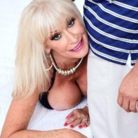 Gorgeous grandma Leah L'Amour sucks and porks a huge dick while her spouse sleeps