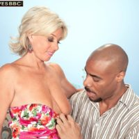 Hot granny Payton Hall is disrobed to a rosy g-string by her younger ebony paramour