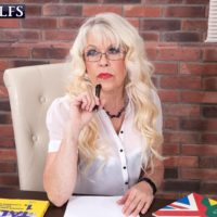 Sexy mature schoolteacher Lady S entices a male student in a black mini-skirt and glasses
