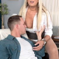 Wonderful senior lady Dallas Matthews exposes her lace underwear while seducing a boy