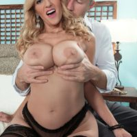 Inviting fair-haired MILF Holly Claus has her immense boobs unveiled before blowing a humungous cock