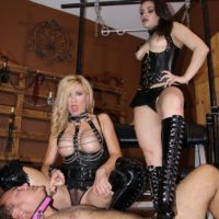 Kimber Woods and Parker trample a nude guy while attired in long black boots
