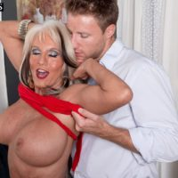 Lanky over 60 MILF Sally D'Angelo having her giant tits liberated from a dress in high-heeled footwear