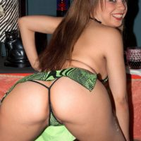 Latina MILF XXX adult star Tia Sweets touting large ass in thong and stilettos