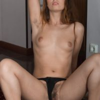 Lengthy legged amateur Nikky showcases her furry underarms and twat as she gets entirely naked