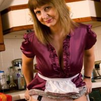 Aged amateur uncups her adorable titties as she gets entirely nude in the kitchen