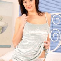 Mature first timer with nice breasts and a shaved muff works partway free of a short sundress