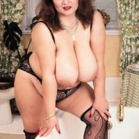 Mature BIG BEAUTIFUL WOMAN Ildiko plays with her large breasts in inviting tights during solo action