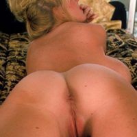Elderly blond Kayla Kleevage takes self shots of her tan lined ass in ebony tights