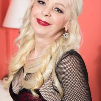 Elder yellow-haired dame Heidi milks and munches a humungous black dick in a bodystocking