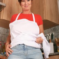 Aged housewife with short red hair bares her massive naturals for her first nude poses