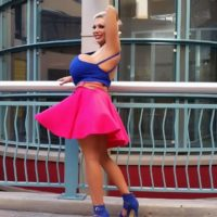 older lady Claudia Marie sports short yellow-haired hair while unsheathing her fake titties