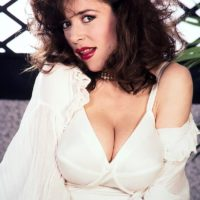 Mature pornostar Diana Wynn releases her massive tits from her retro styled bras