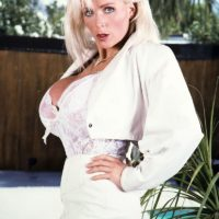 Elder XXX starlet Platinum Peaks frees immense tits from brassiere in lace panties and stilettos